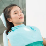 Photo of dental patient resting in dental chair