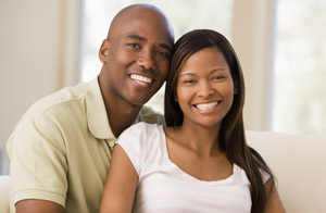 Relaxed couple with whitened smiles