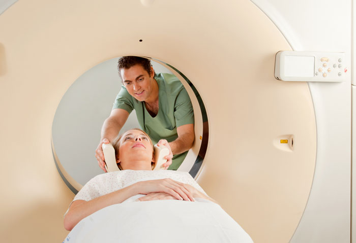 A radiologist performing a CT scan on a patient