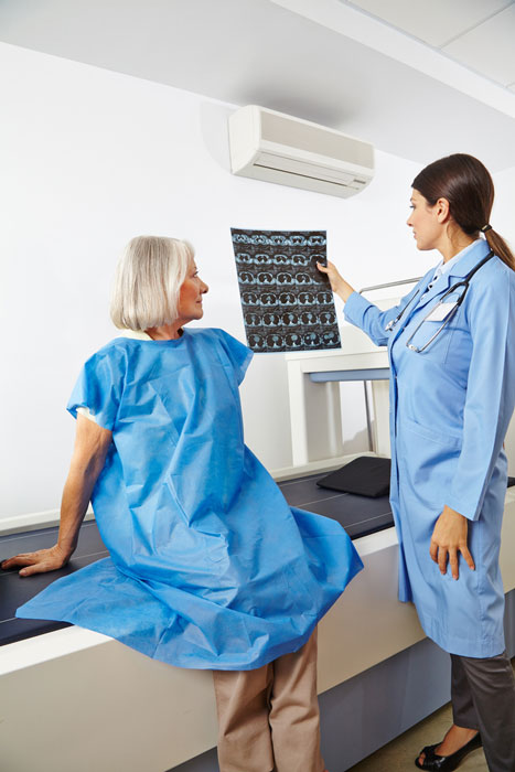Patient and doctor reviewing an x-ray